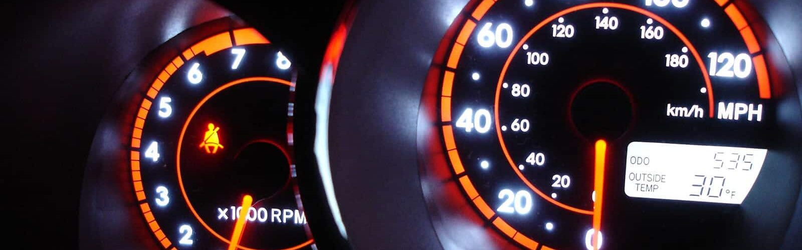 Photo of vehicle dashboard lit up at night