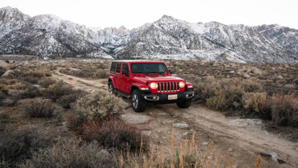 Jeep Wrangler driving offroad on the hills