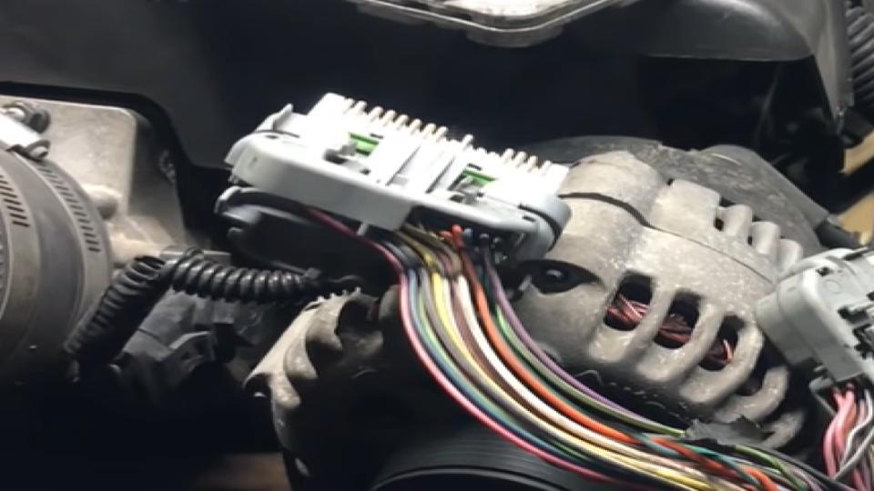 tcm on a truck above the alternator